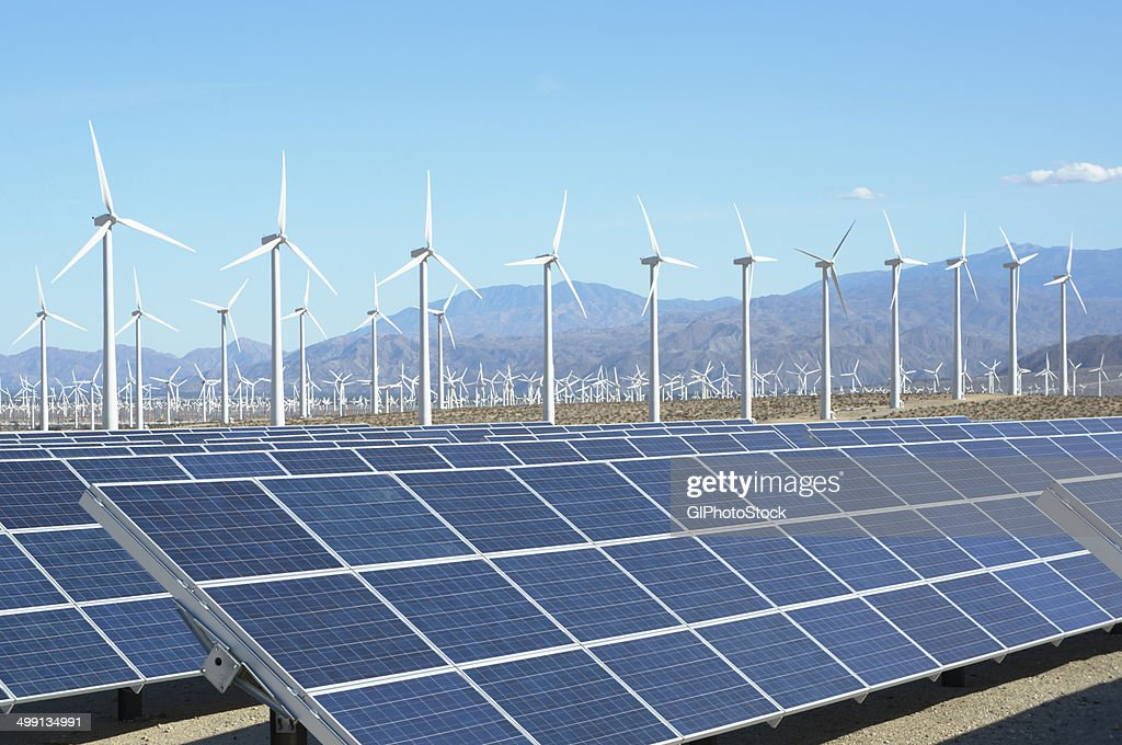 Photovoltaic solar panels and wind turbines, San Gorgonio Pass Wind Farm, Palm Springs, California, USA. This solar installation has a 2.3 MW capacity : Stock Photo