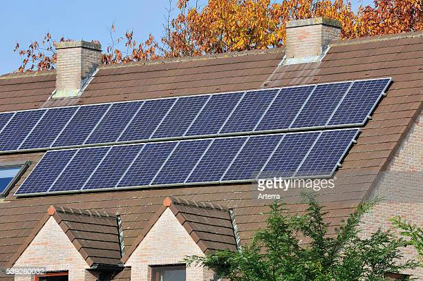 Photovoltaic solar panels on roof of house