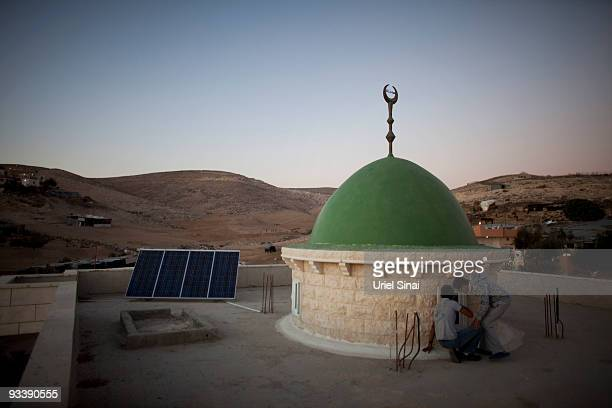 Photovoltaic solar panels provide electricity to the local mosque on November 23 2009 in the Bedouin Arab village of Darajat in Israel's Negev desert...
