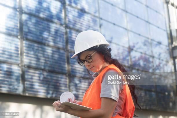 photovoltaic technician at work at residential building - sigrid gombert stock-fotos und bilder