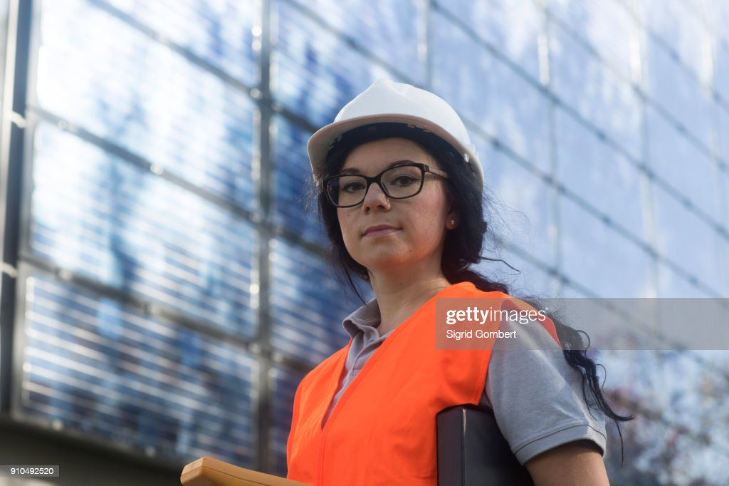 Photovoltaic technician at work at residential building : Stock-Foto