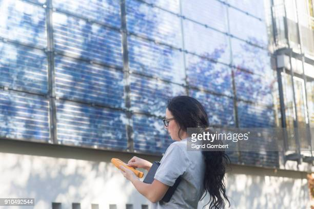 photovoltaic technician at work at residential building - sigrid gombert stock pictures, royalty-free photos & images