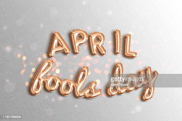 phrase 'april fools day in foiled balloon - idiots stock pictures, royalty-free photos & images