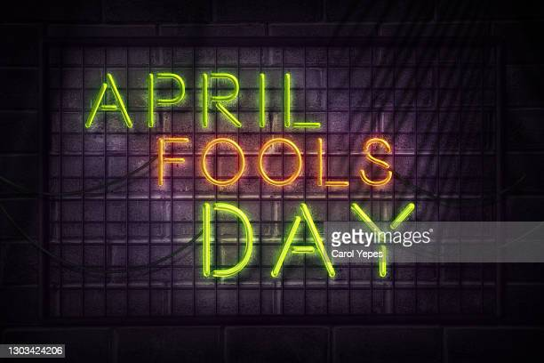 phrase 'april fools day in neon style - comedian stock pictures, royalty-free photos & images