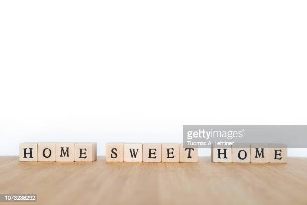 phrase made of wooden dice - home sweet home stock pictures, royalty-free photos & images
