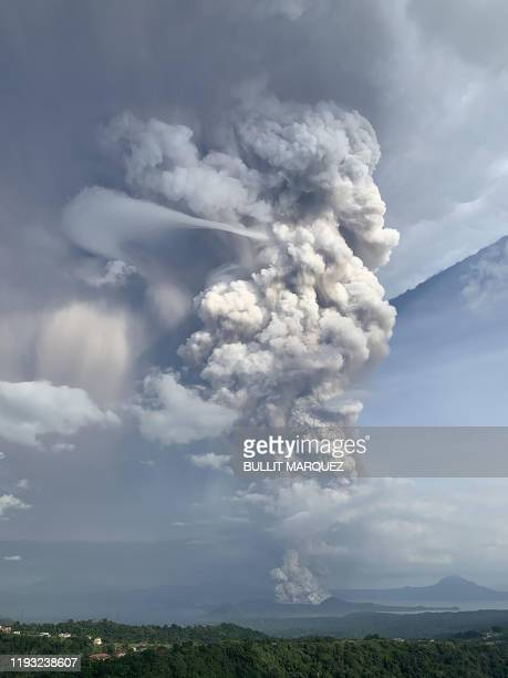 A phreatic explosion from the Taal volcano is seen from the town of Tagaytay in Cavite province southwest of Manila on January 12 2020