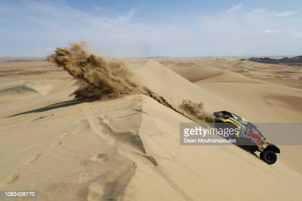 PhSport no 306 PEUGEOT 3008 DKR car driven by Sebastien Loeb of France and Daniel Elena of Monaco compete in the sand desert and dunes during Stage...