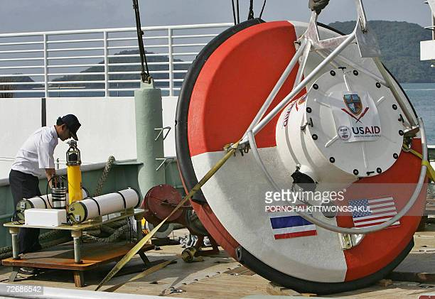 A Thai official final checks the first tsunami warning buoy at the Cape Panwa in Phuket island southern of Thailand 01 December 2006 Thailand will...