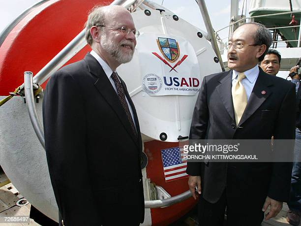 Thai Foreign Minister Nitya Pibulsonggram and US embassador to Thailand Ralph L Boyce stand in front of the first tsunami warning buoy at the Cape...