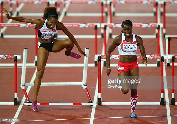 Phylicia George of Canada hits the hurdle as Serita Solomon of England competes in the Women's 100 metres hurdles heats at Hampden Park during day...