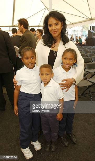 Phylicia Rashad poses with Breana Armand, Chris Armand and Taylor Armand, all accelerated school students.