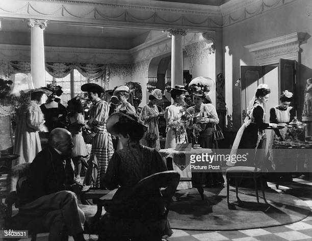 Phyllis Calvert attends a tea party in a scene from the 20th Century Fox comedy 'Kipps', alternatively titled 'The Remarkable Mr Kipps'. Original...