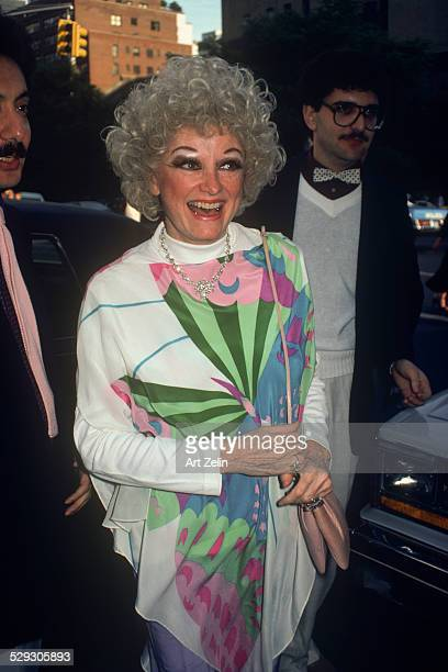 Phyllis Diller in a pink green and blue butterfly dress circa 1970 New York