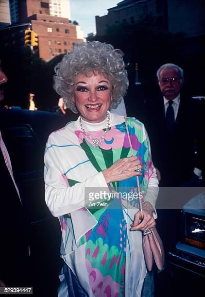 Phyllis Diller wearing a butterfly silk dress circa 1980 New York