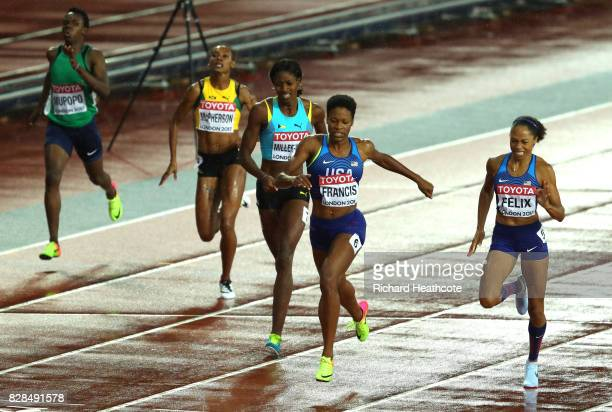 Phyllis Francis of the United States and Allyson Felix of the United States cross the finish line ahead of Shaunae MillerUibo of the Bahamas in the...