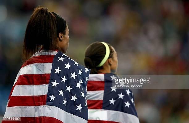 Phyllis Francis of the United States and teammate Allyson Felix look on after winning gold in the Women's 4 x 400 meter Relay on Day 15 of the Rio...