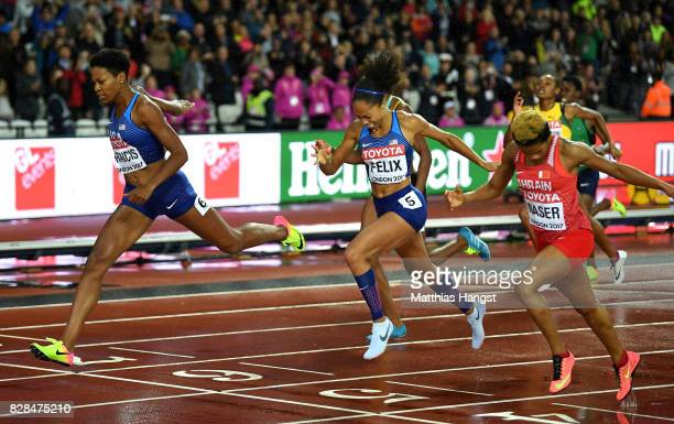 Phyllis Francis of the United States Salwa Eid Naser of Bahrain and Allyson Felix of the United States cross the finish line in the Women's 400...