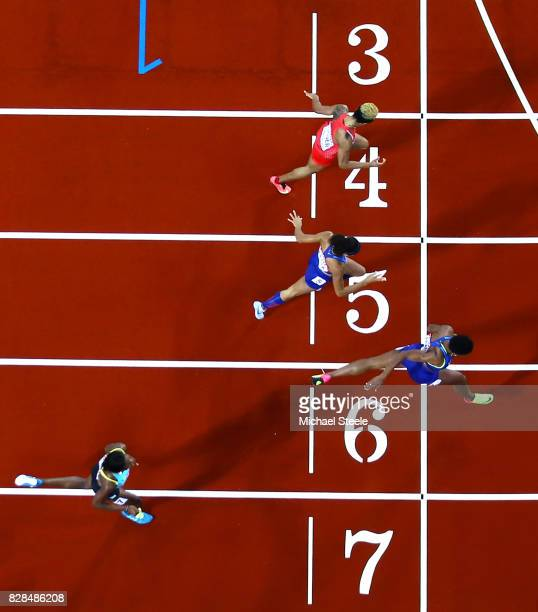 Phyllis Francis of the United States Salwa Eid Naser of Bahrain and Allyson Felix of the United States cross the finish line ahead of Shaunae...