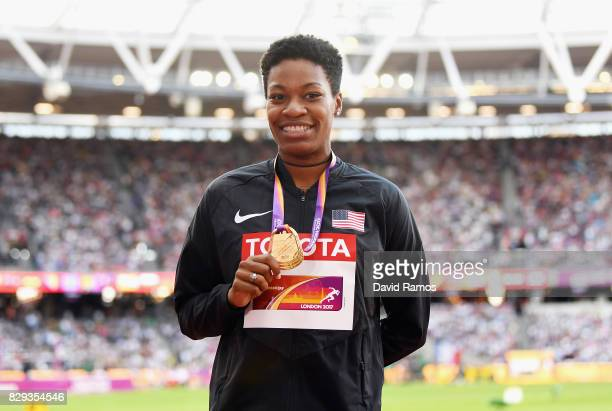 Phyllis Francis of United States poses with her gold medal won following the womens 400m final during day seven of the 16th IAAF World Athletics...