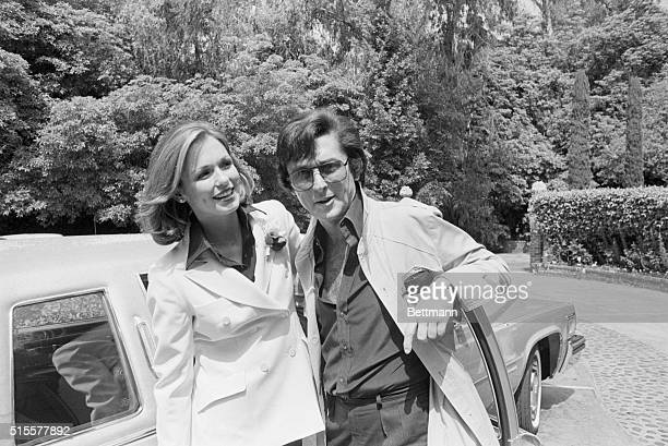 Phyllis George and Robert Evans pause for a picture after exchanging wedding vows under a 400 year old sycamore tree on Evan's Beverly Hills property...
