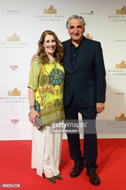 Phyllis Logan and Jim Carter pose for a photo during the Downtown Abbey The Exhibition Red Carpet at the Sands Expo and Convention Centre on June 21...