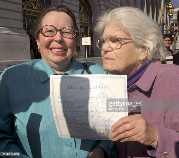 Phyllis Lyon and Del Martin both of San Francisco hold their marriage certificate after they are the first same sex couple to be married as many same...