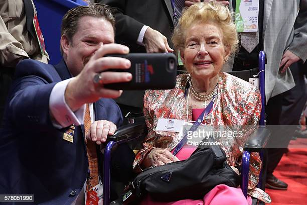 Phyllis Schlafly president of the Eagle Forum poses for a selfie with a fan on the floor during the second day of the Republican National Convention...