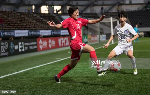 Phyong Sim of DPR Korea and Kim Hyeri of South Korea in action during the EAFF E1 Women's Football Championship between North Korea and South Korea...
