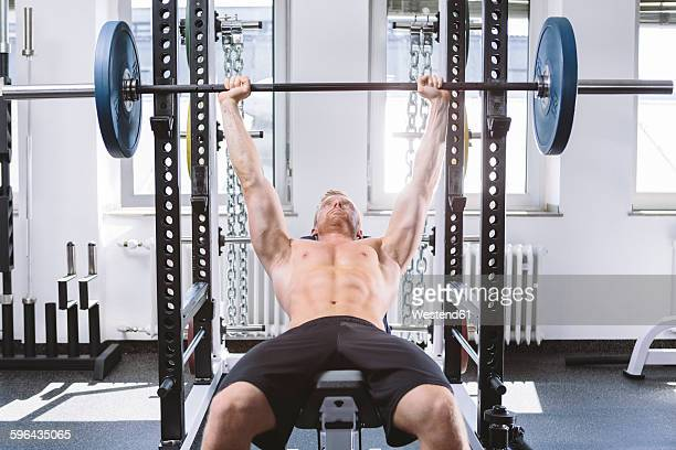 Physical athlete doing bench presses