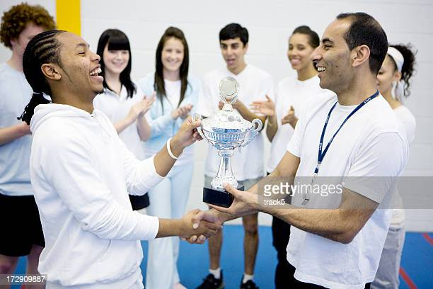 physical education: congratulating the winner - teen awards stock photos and pictures