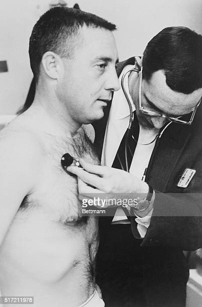 Physical examinations are routine for the National Aeronautics and Space Administration astronauts Here Virgil I Grissom is examined during...