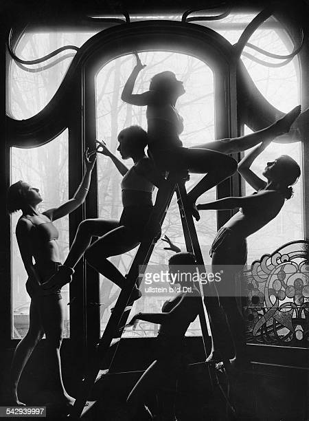 Physical exercises Five women doing exercises on a ladder in a gym in Berlin - 1929 - Vintage property of ullstein bild