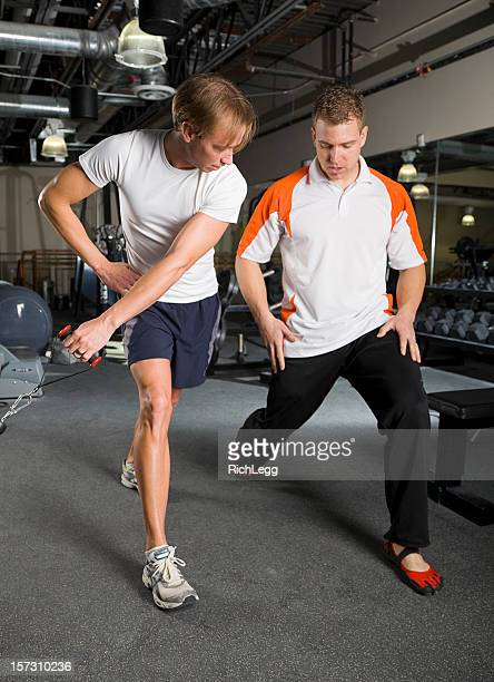 physical fitness trainer in a gym - rich_legg stock photos and pictures