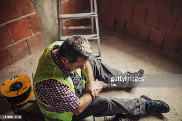 physical injury at work of construction worker - falling stock pictures, royalty-free photos & images