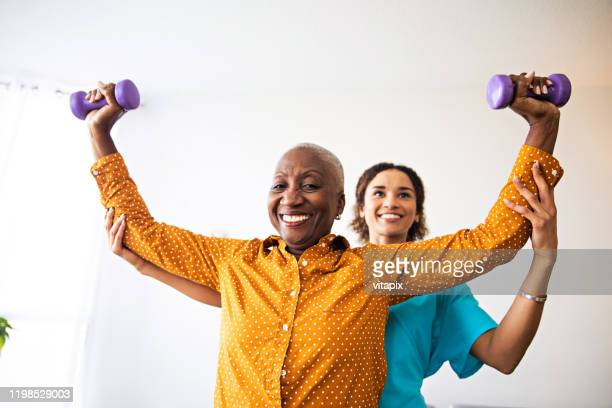 physical injury recovery - physical therapy stock pictures, royalty-free photos & images