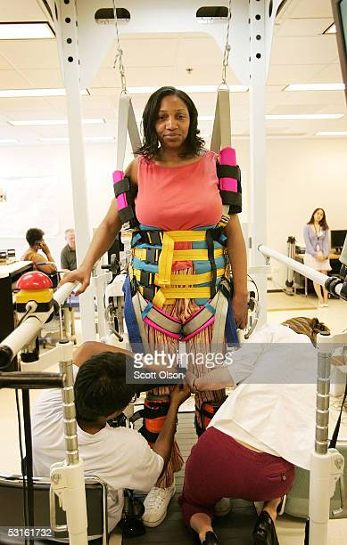 Physical Therapist Assistant Donielle Campbell and graduate student Jeffrey Israel strap gun shot victim Gernard Fulton into a Locomat robotassisted...