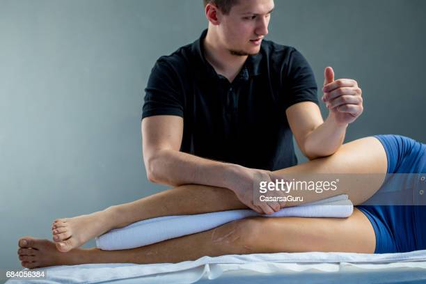Physical Therapist Checking Woman's Leg