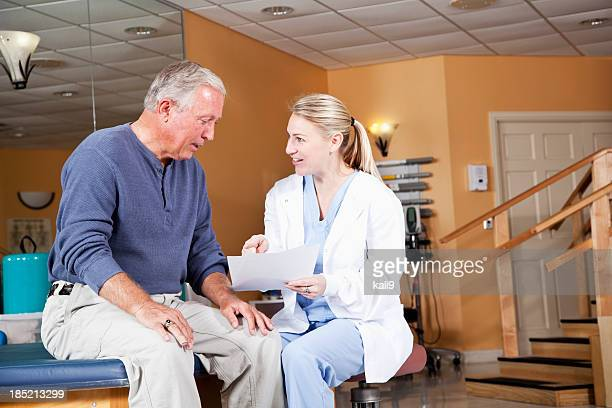 Physical therapist explaining treatment plan to patient