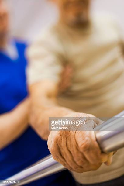 Physical Therapist holding a patient while walking
