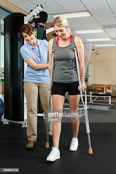 Physical therapist isntructing patient on proper use of crutches
