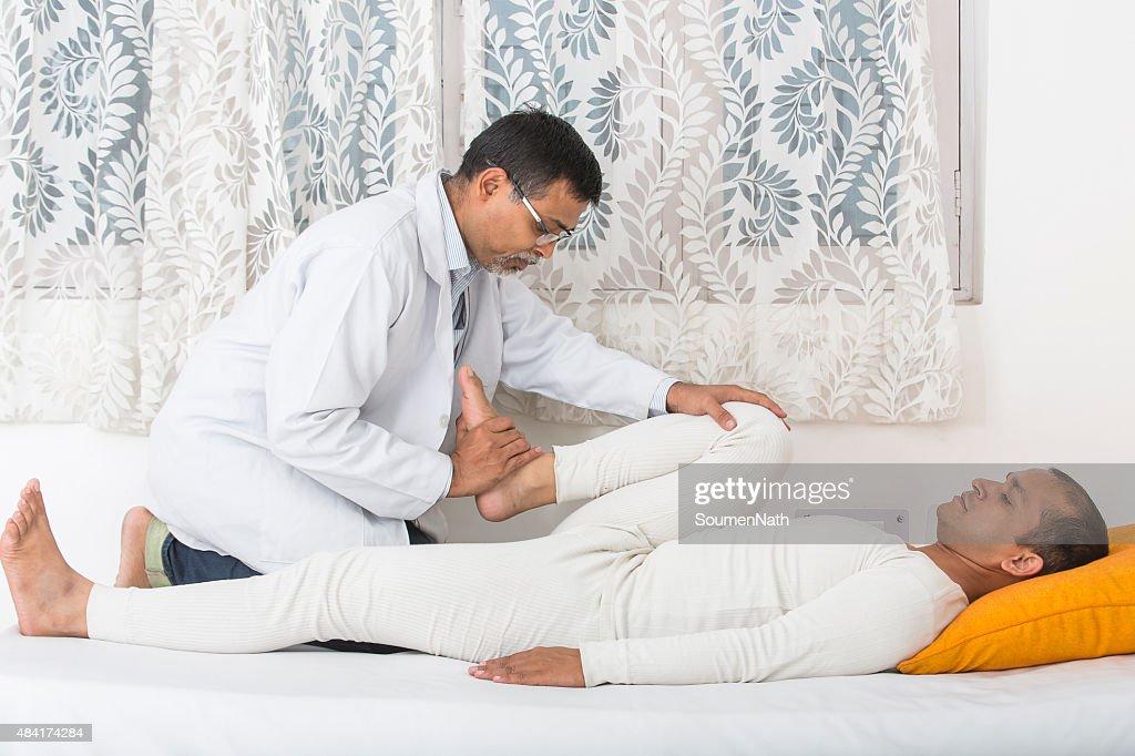 Physical Therapist Series: Leg exercise : Stock Photo