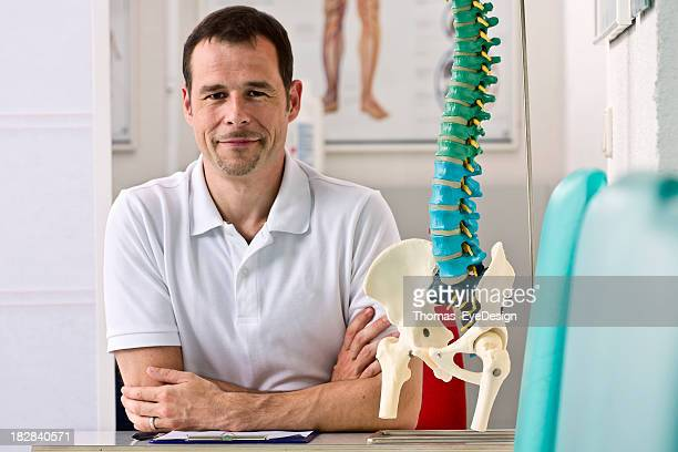 Physical Therapist Sitting at his Desk