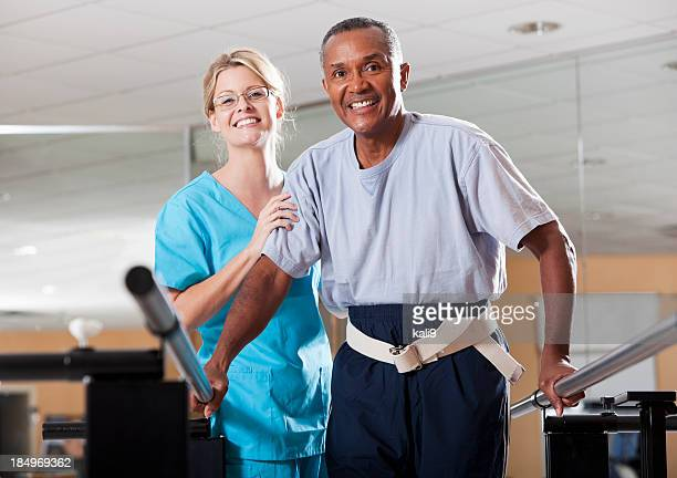 physical therapist working with a patient - bounce back stock photos and pictures