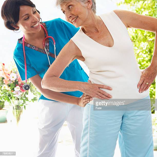 Physical Therapist Working with Senior Woman