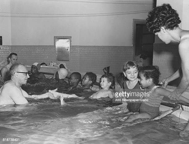 Physical therapists and polio victims in a pool at Philadelphia General Hospital Philadelphia Pennsylvania December 21 1963