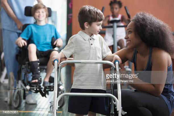 Physical therapists helping children