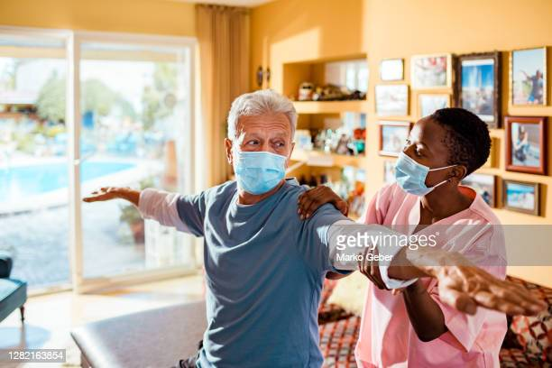 physical therapy at home - recovery stock pictures, royalty-free photos & images