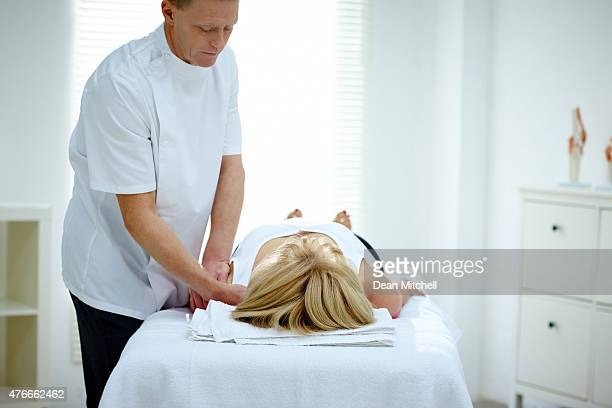 Physical therapy on neck of woman