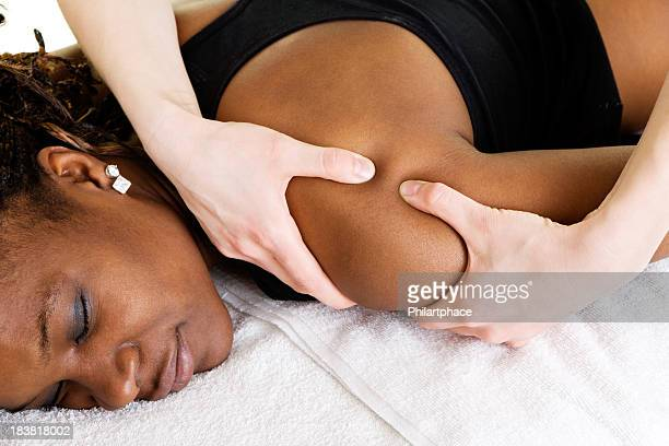 physical therapy - massage black woman stock photos and pictures