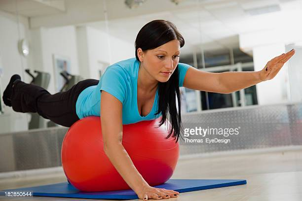 physical therapy with exercies ball - lower back stock pictures, royalty-free photos & images